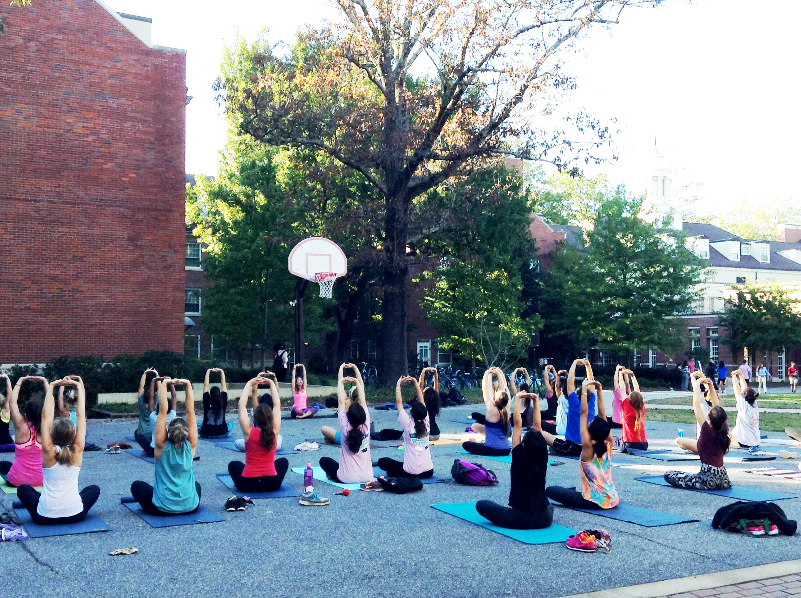 Students practicing yoga with University Health Center instructor Alice Huff