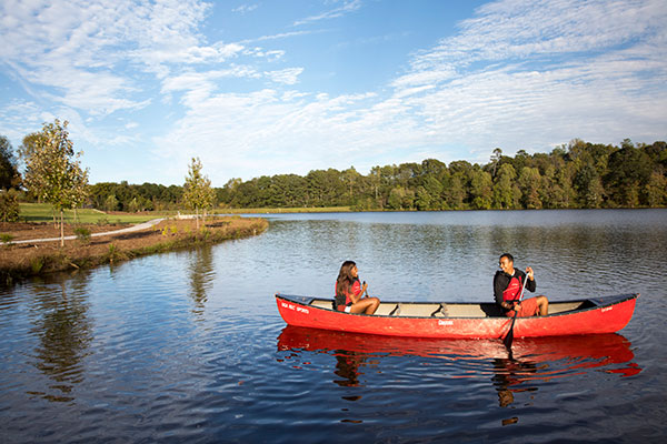 students canoeing at UGA's Lake Herrick